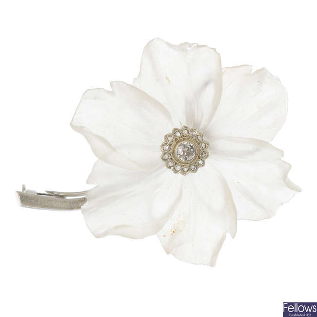 A diamond and glass floral brooch.