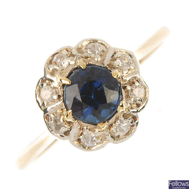 An mid 20th century 18ct gold and platinum sapphire and diamond cluster ring.