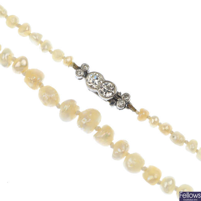 An early 20th century natural pearl necklace, with diamond clasp.