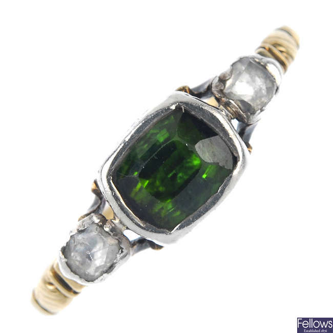 A mid 19th century silver and 18ct gold tourmaline and diamond three-stone ring.