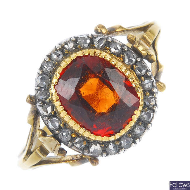 A late 19th century 9ct gold hessonite garnet and diamond cluster ring.