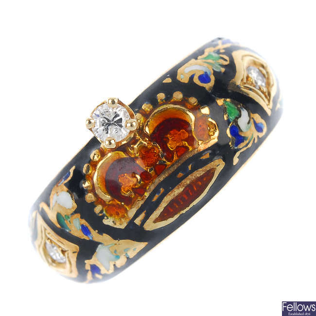 An enamel and diamond band ring.