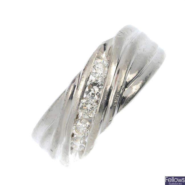 A platinum diamond dress ring.
