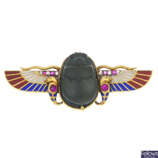 An 18ct gold Egyptian Revival gem-set winged scarab brooch.