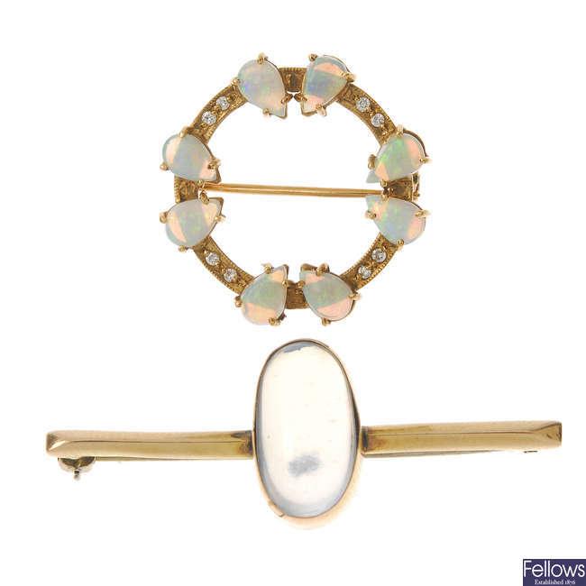 A 9ct gold moonstone brooch and an opal an diamond wreath brooch.