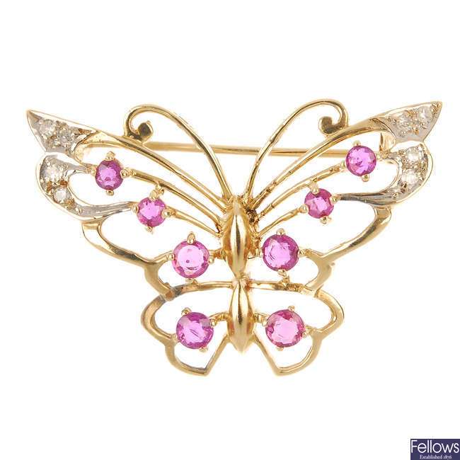A 9ct gold ruby and diamond butterfly brooch.