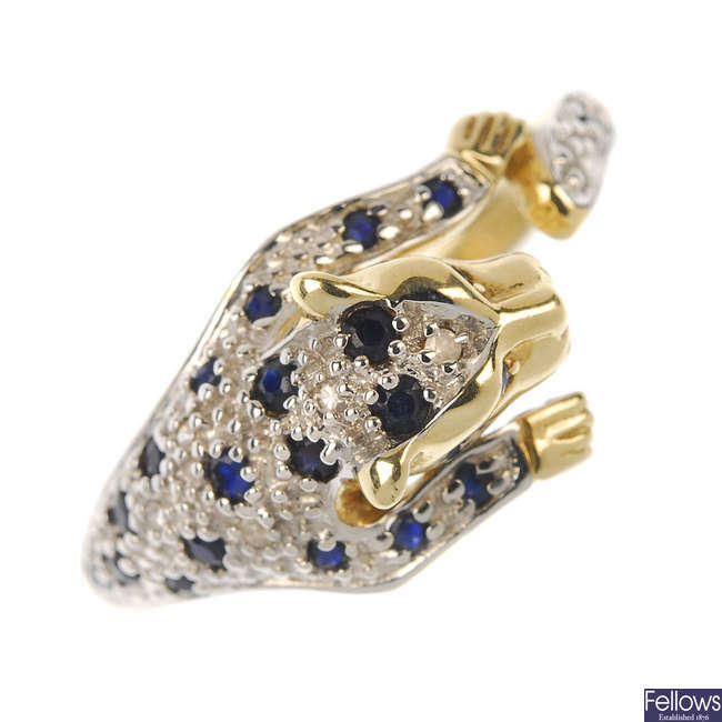 A 9ct gold diamond and sapphire leopard ring.