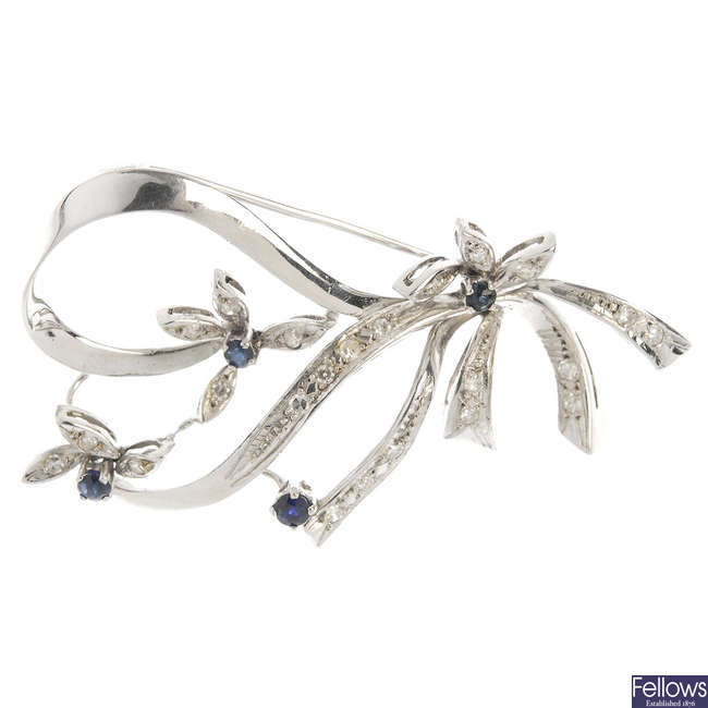 A diamond and sapphire floral brooch.