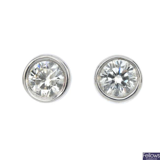 A pair of 18ct gold diamond ear studs.
