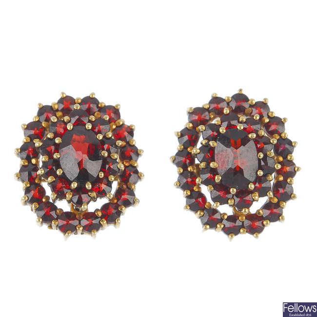 Two pairs of gem-set earrings.