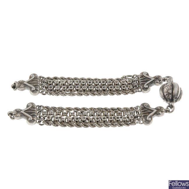 A white metal fancy link chain.