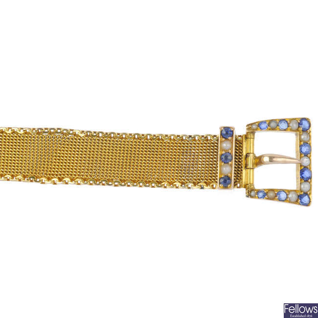 An early 20th century 9ct gold split pearl and sapphire buckle bracelet.