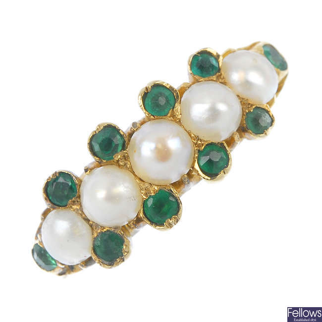 A cultured pearl and emerald dress ring.