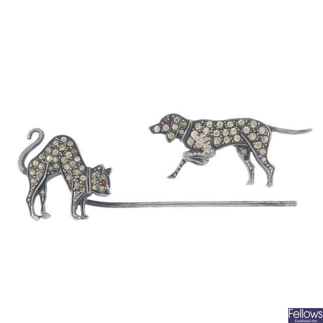 A paste cat and dog jabot pin.