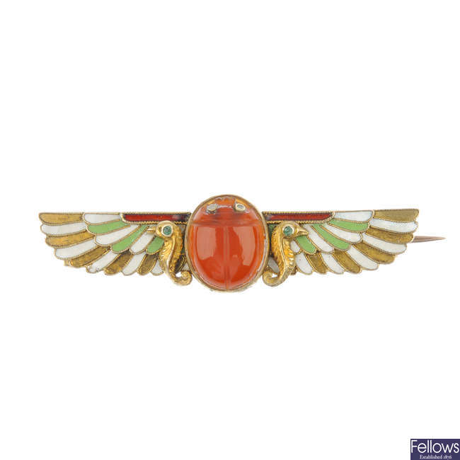 An early 20th century Egyptian revival enamel and gem-set winged scarab brooch.