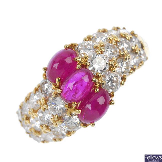 A ruby and diamond three-row dress ring.