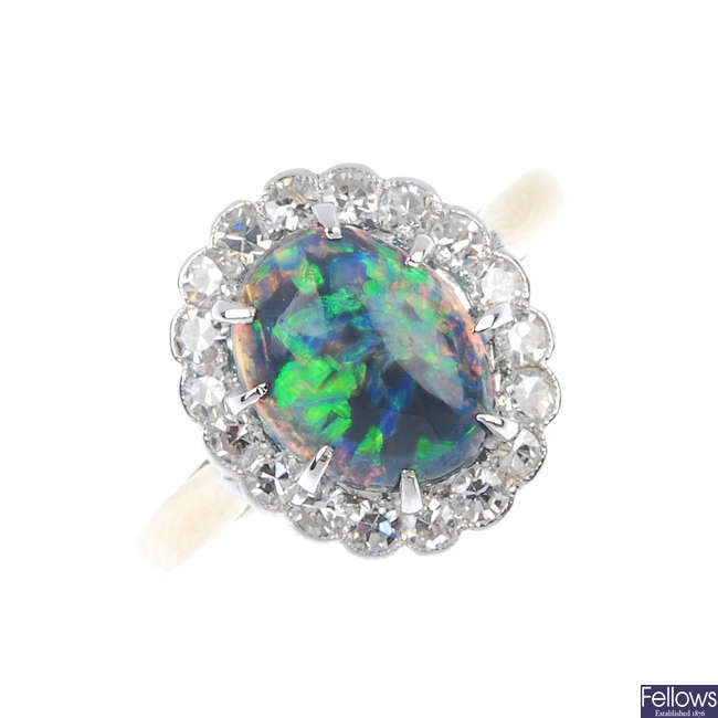 A mid 20th century black opal and diamond cluster ring.