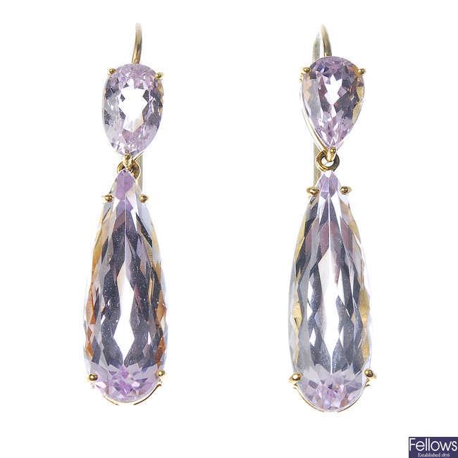 A pair of kunzite ear pendants.