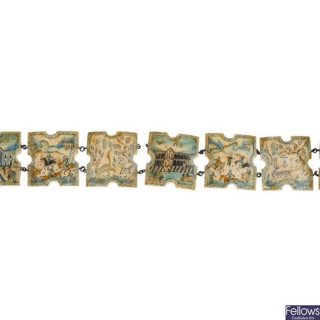 A hand painted Persian bone panel belt.