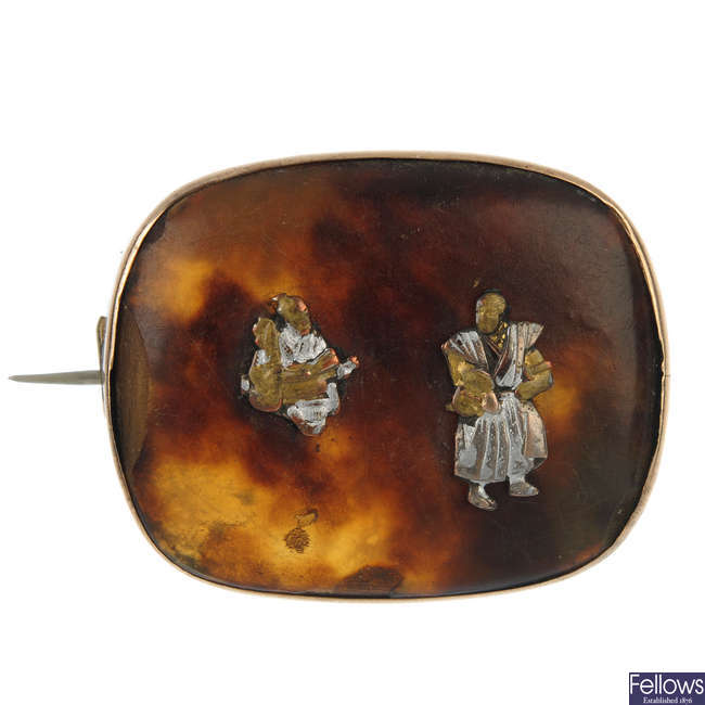 A tortoiseshell brooch.