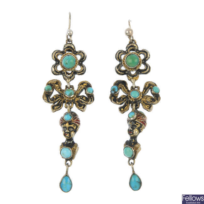 A pair of early 20th century turquoise and enamel blackamoor ear pendants.