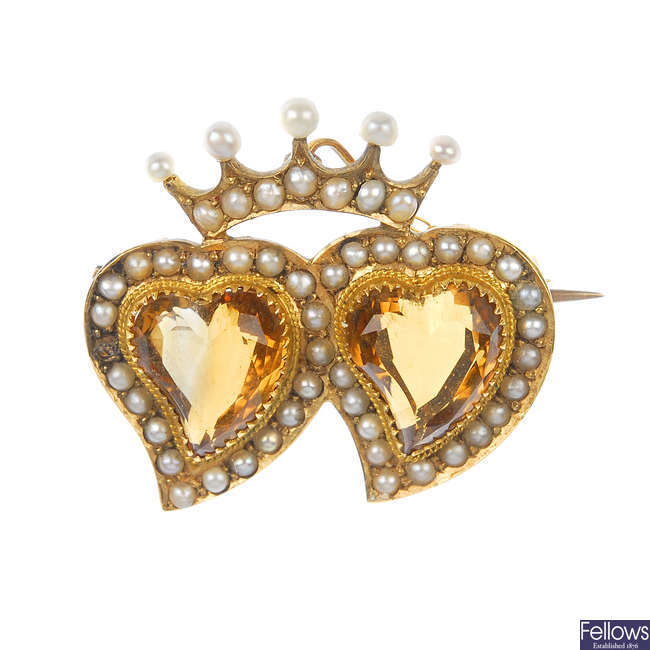An early 20th century 15ct gold citrine and seed pearl heart brooch