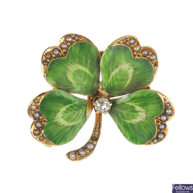 An early 20th century gold enamel, diamond and seed pearl four-leaf clover brooch.