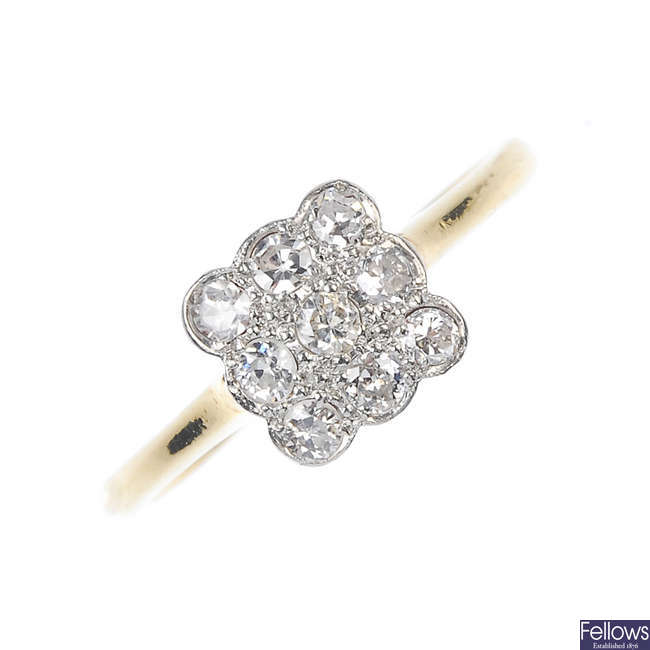An early 20th century platinum and 18ct gold diamond cluster ring.