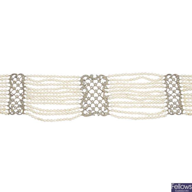 An early 20th century imitation pearl and paste silver gilt choker
