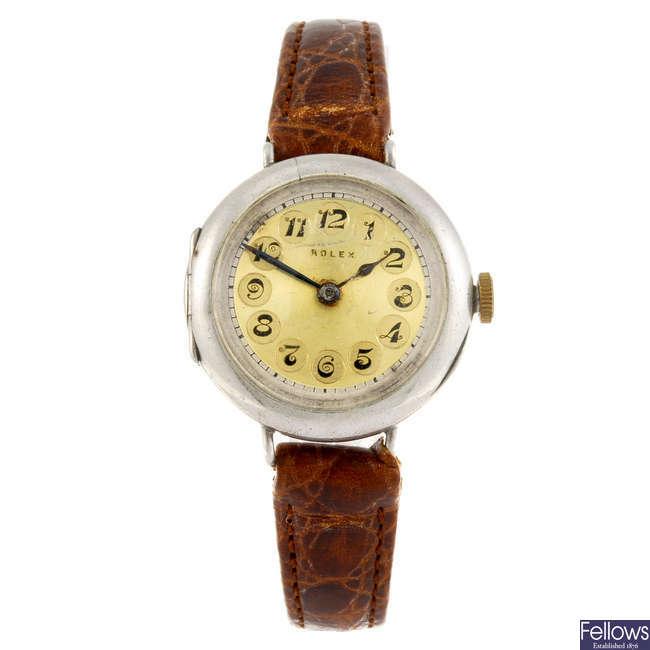 ROLEX - a trench wrist watch.