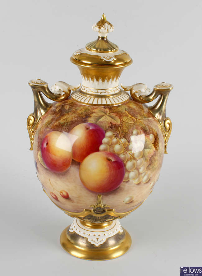 A Royal Worcester bone china twin handled pedestal vase and cover