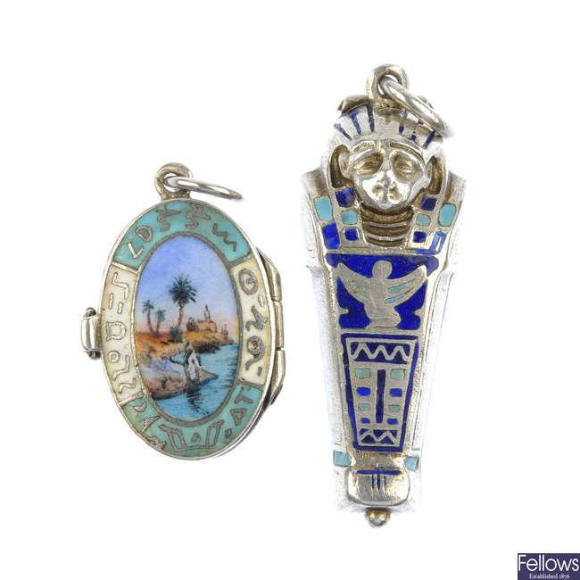 Two Egyptianesque enamel hinged pendants.