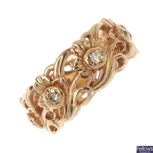 A diamond foliate band ring.
