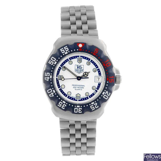 TAG HEUER - a mid-size Formula 1 bracelet watch.