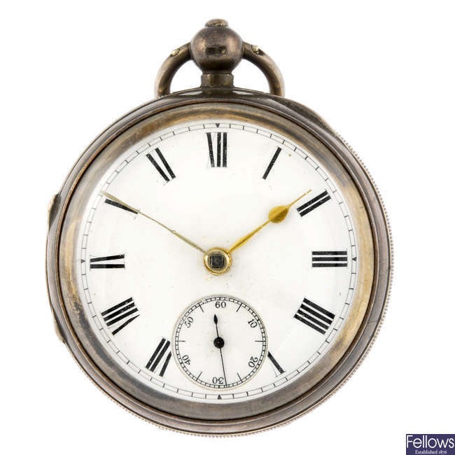 A silver open face pocket watch.