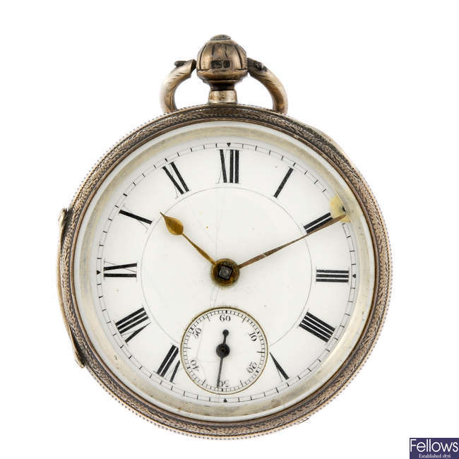 A silver open face pocket watch by P.C Chatland with two white metal open face pocket watches.