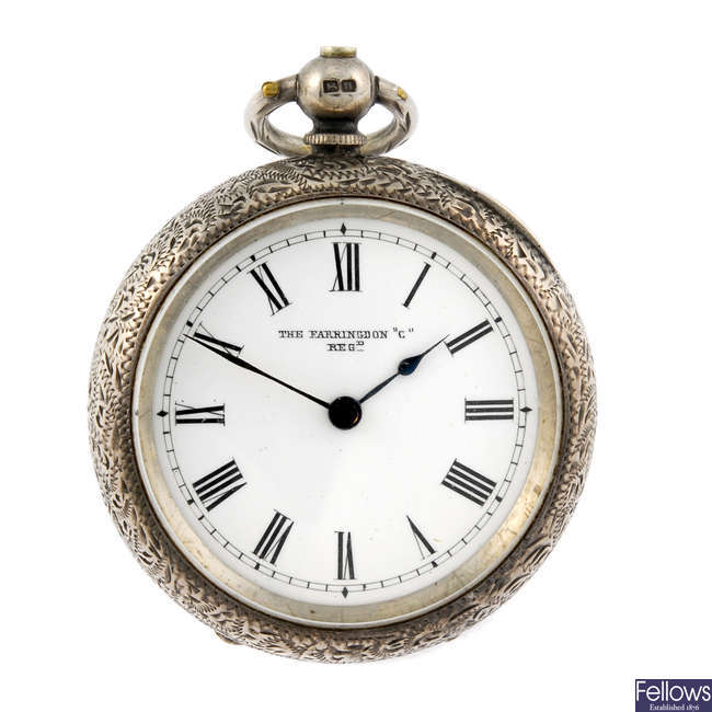 A silver open face pocket watch with a white metal open face pocket watch.