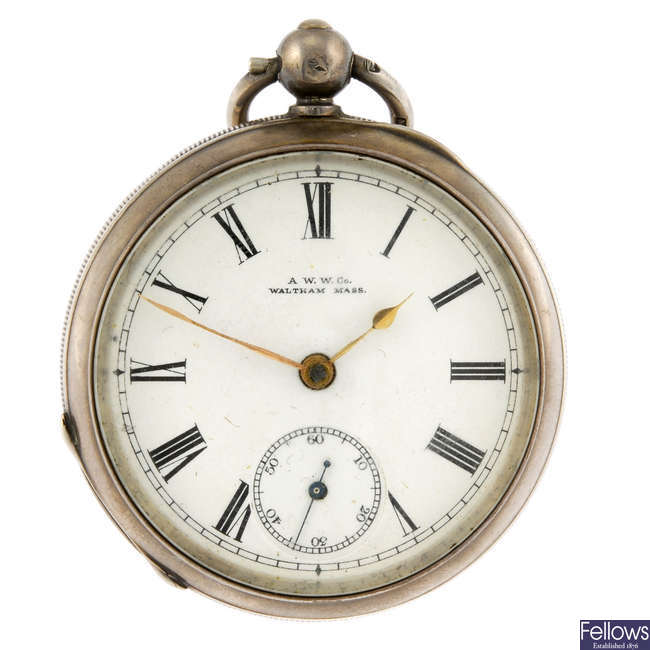 A silver open face pocket watch by Waltham with two silver open face pocket watches.