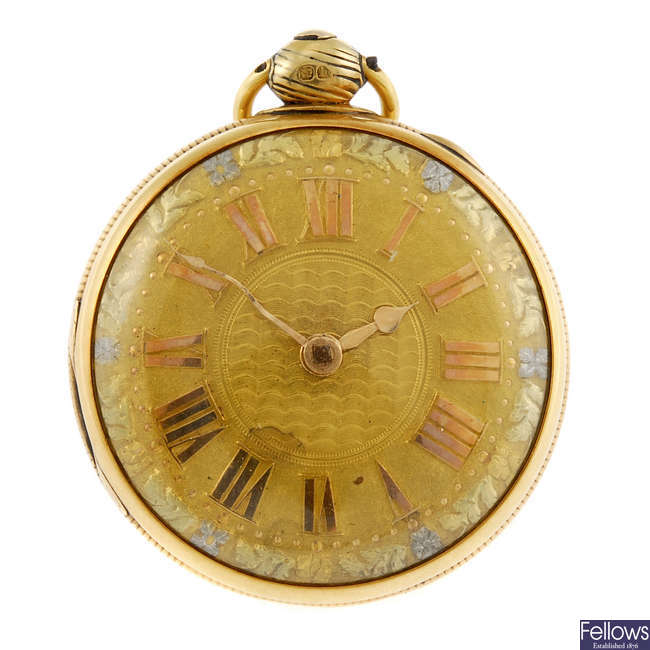 An 18k gold open face pocket watch by W.T. Dulin.
