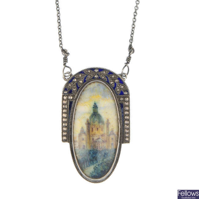 An Austrian early 20th century silver pendant with chain.