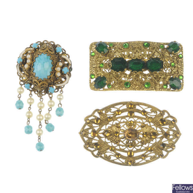 Seven Czechoslovakian style brooches.