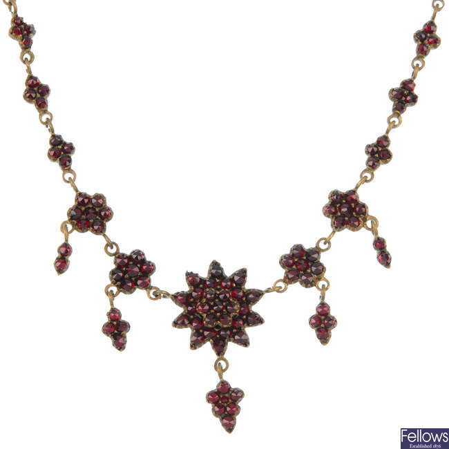 Four items of garnet and red paste jewellery.