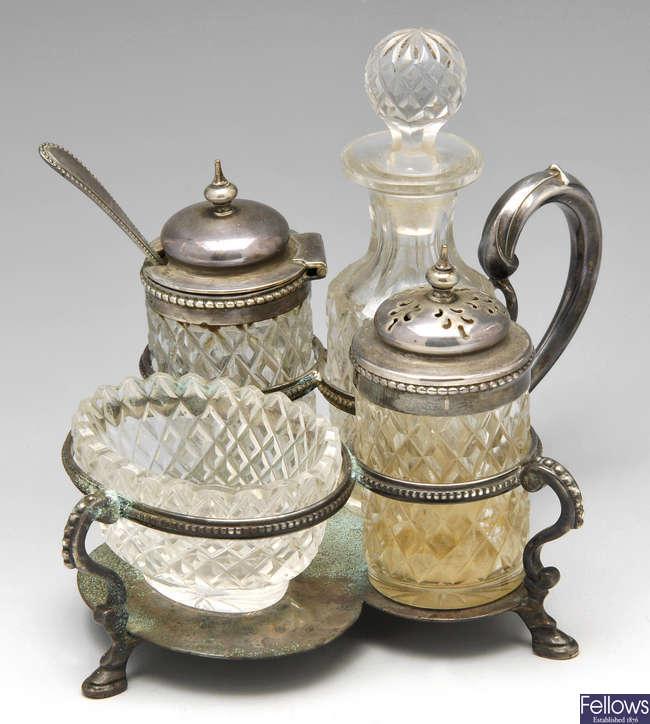 A mid-Victorian silver and glass cruet set.