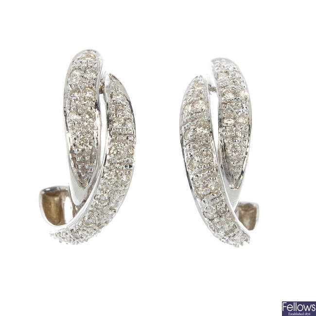A pair of 18ct gold diamond ear cuffs.