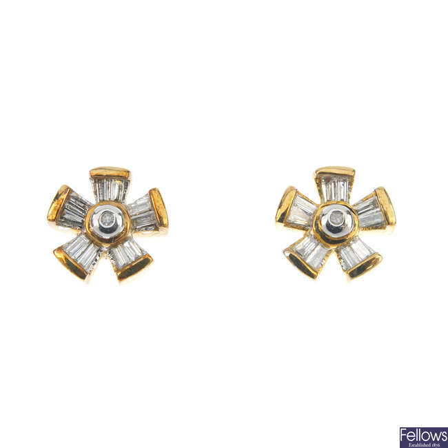 A 9ct gold diamond pendant and matching ear studs.