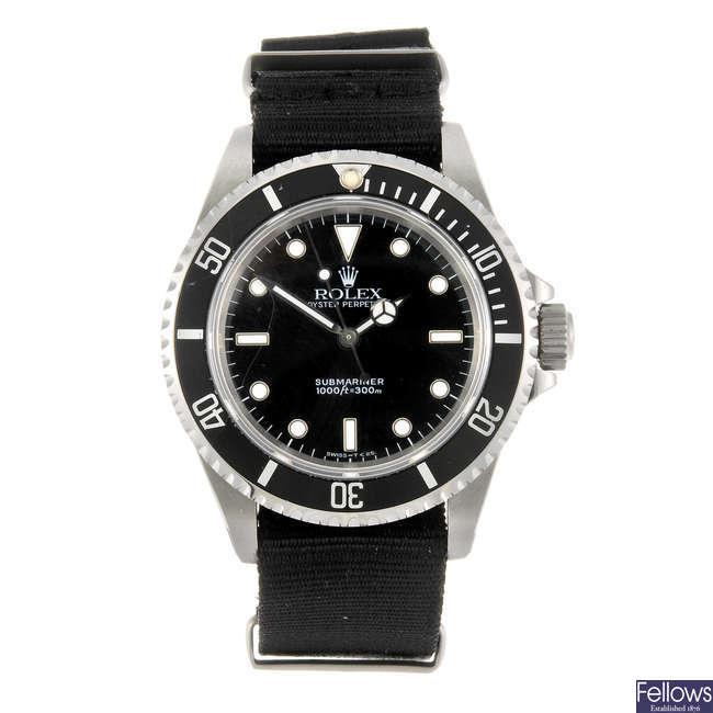 ROLEX - a gentleman's Oyster Perpetual Submariner wrist watch.