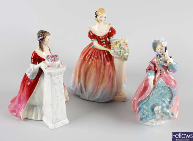 A group of seven figures to include Royal Dolton and Coalport examples, etc.