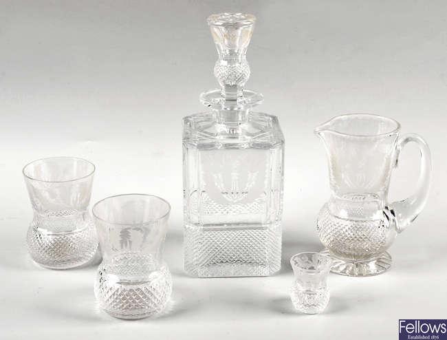 A cut glass nine piece scotch whisky set