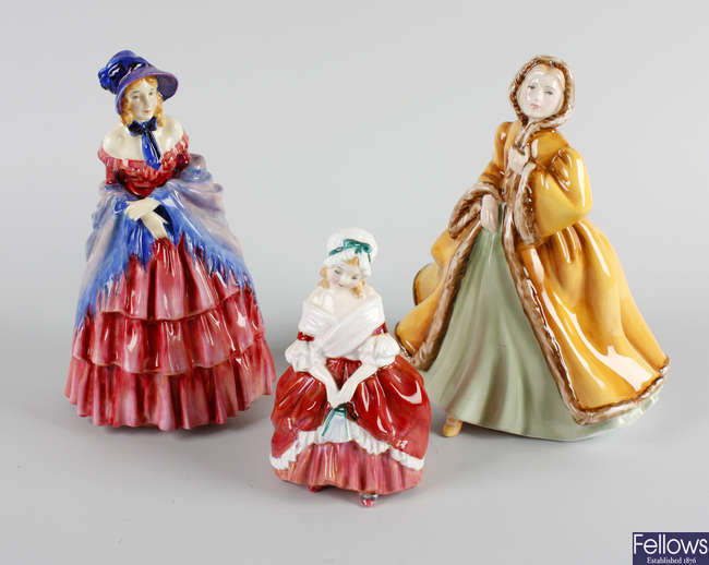 A group of four Royal Doulton figures