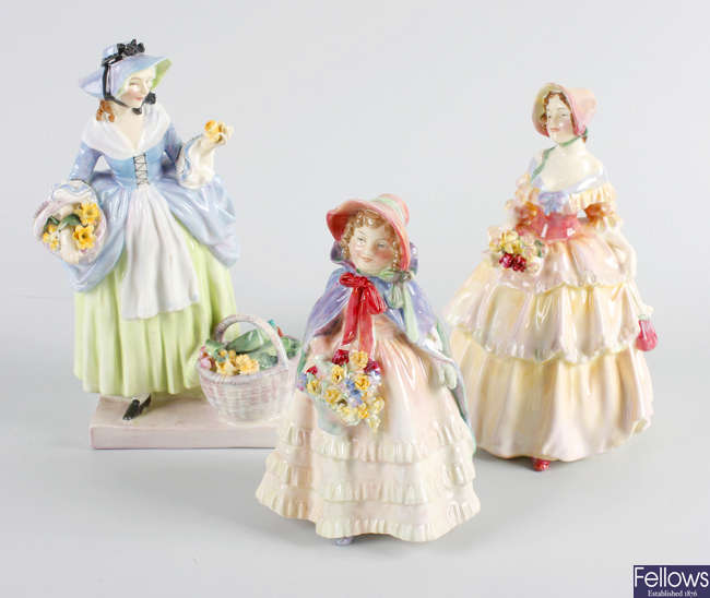 A group of five Royal Doulton figures